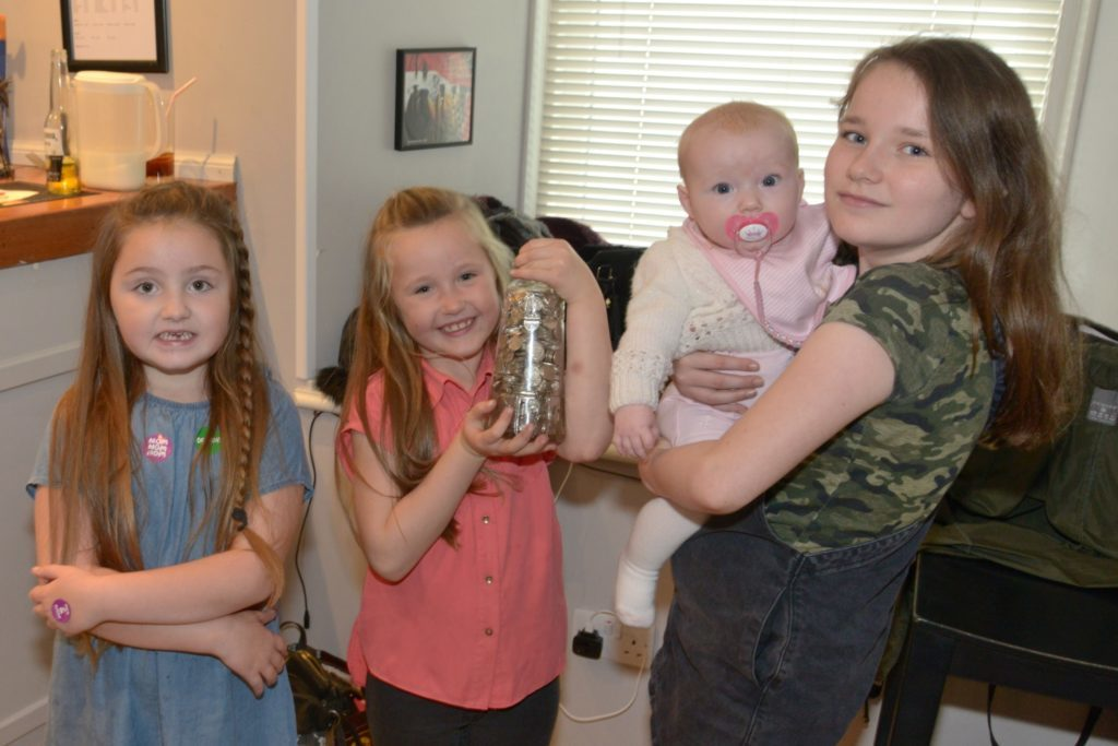 Running the five pences in a jar competition were from left: Lillyannah Burnfield, 6, Maisey Graham, 6, Hannah Shields, 10 and Emilie, six months.