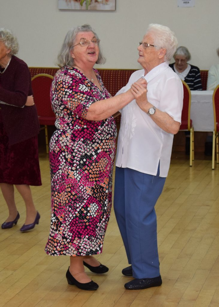 Cathy Duncan and Isabel Conley, who recently celebrated her 80th birthday, enjoyed and sing and a dance.