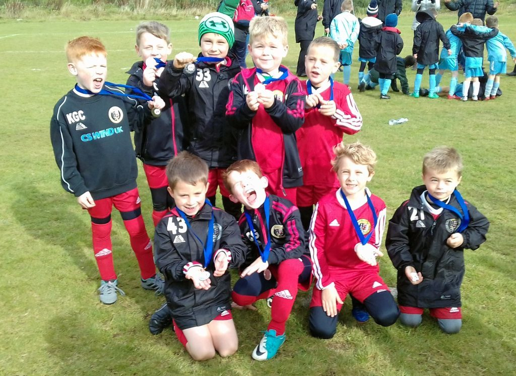 Campbeltown Barcelona and Campbeltown Real Madrid 2011s with their medals.