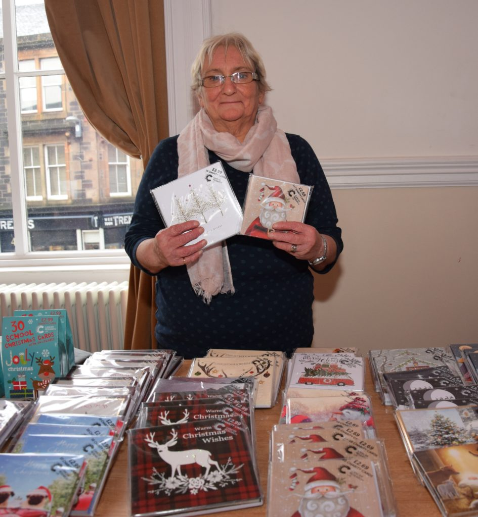 Dorothy McCormick sold a range of charity cards at the Cancer Research coffee morning.