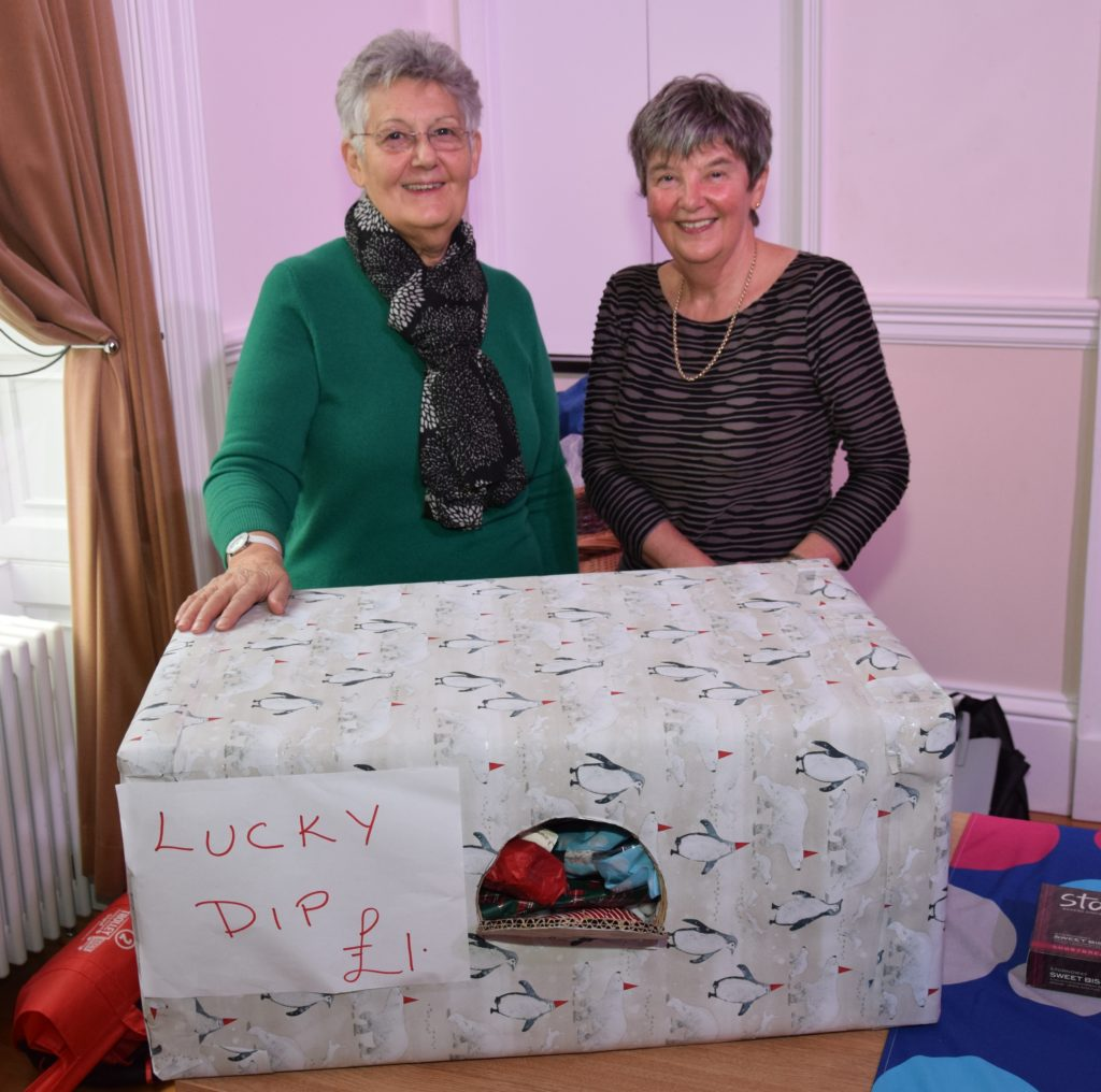 Pat McPherson and Valerie Nimmo manned the Christmas lucky dip stall in the town hall.