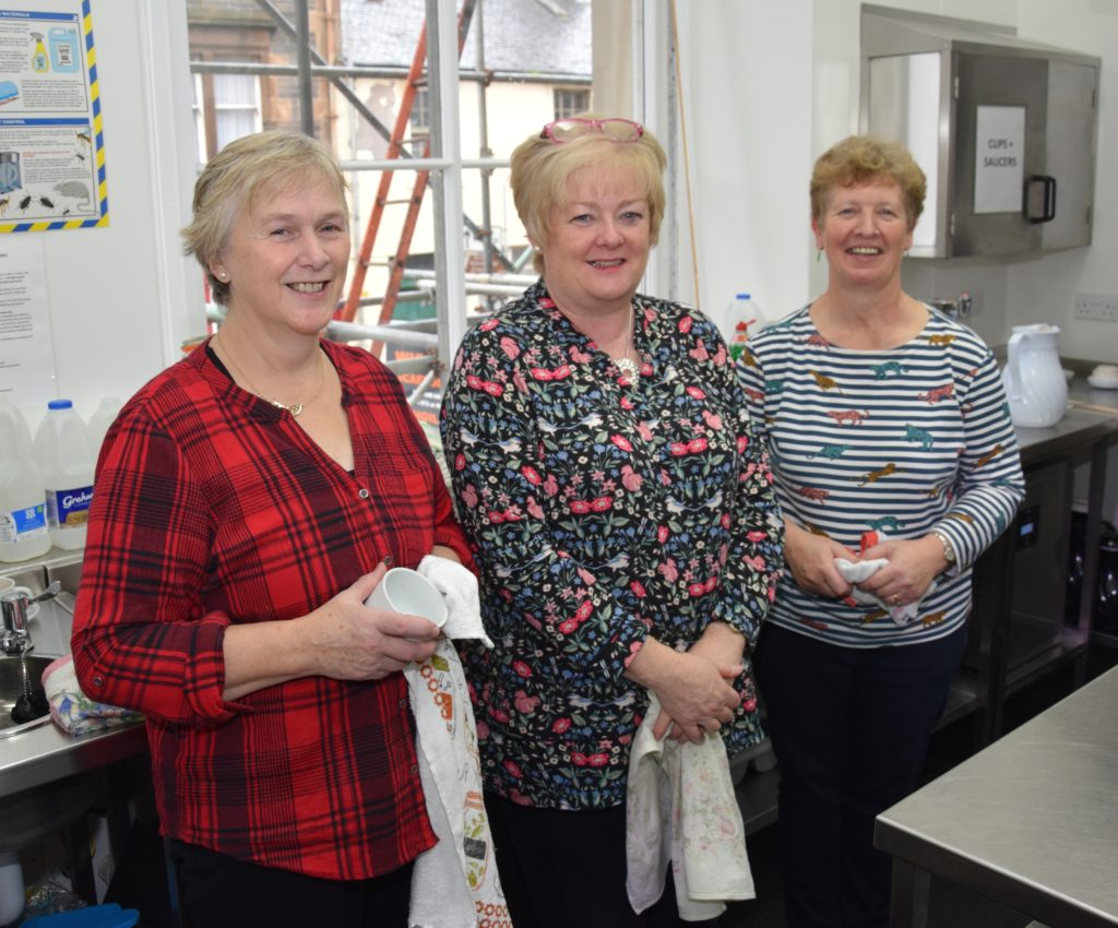 Mary Cameron, Moira Menzies and Inez Ronald worked hard in the town hall kitchen.