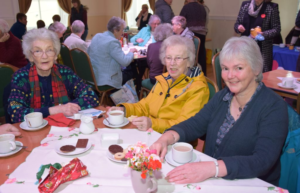Catherine Walker, Irene O'Neill and Susie O'Neill enjoyed a cuppa at the Cancer Research fundraiser.