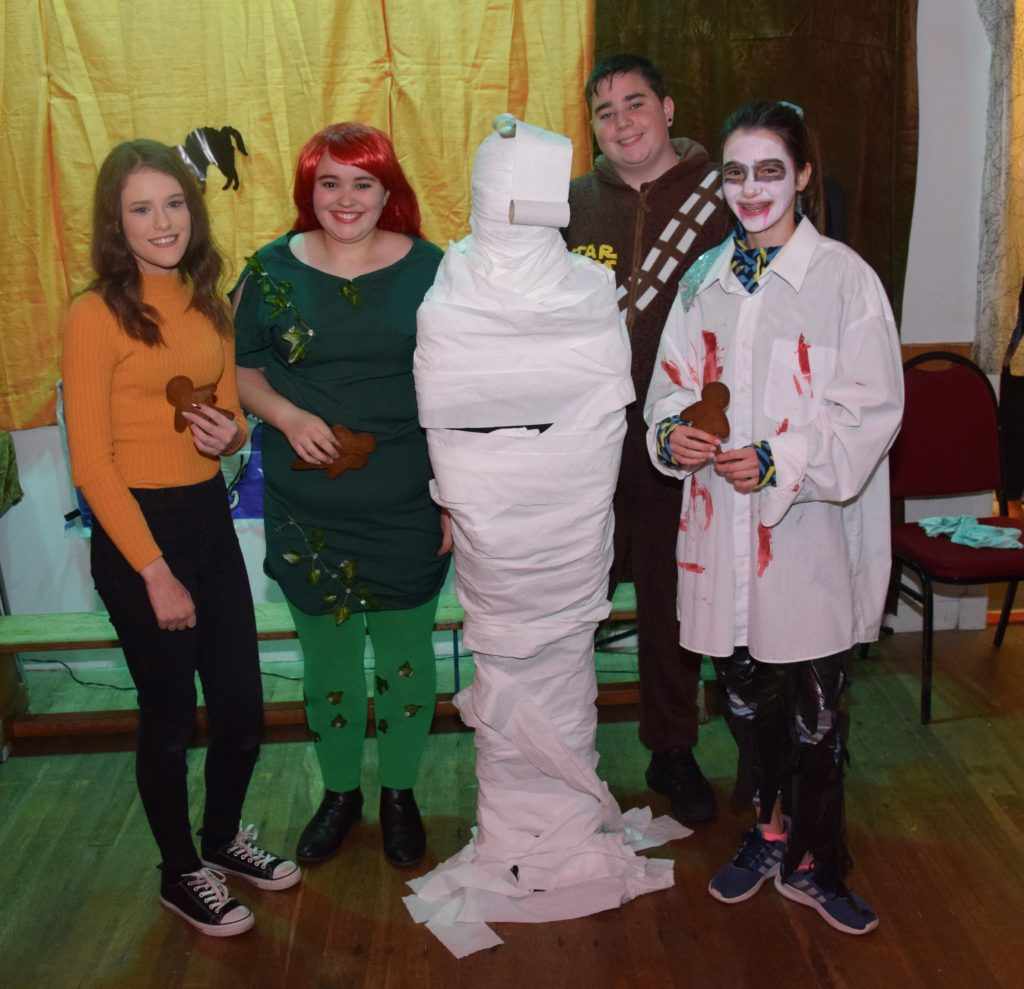 The winning mummy wrap team, with barely a gap on their finished mummy.