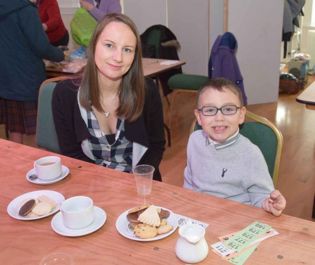 Caiden Andrew, six, enjoyed a biscuit as his mum, Leona McCallum, had a cuppa.