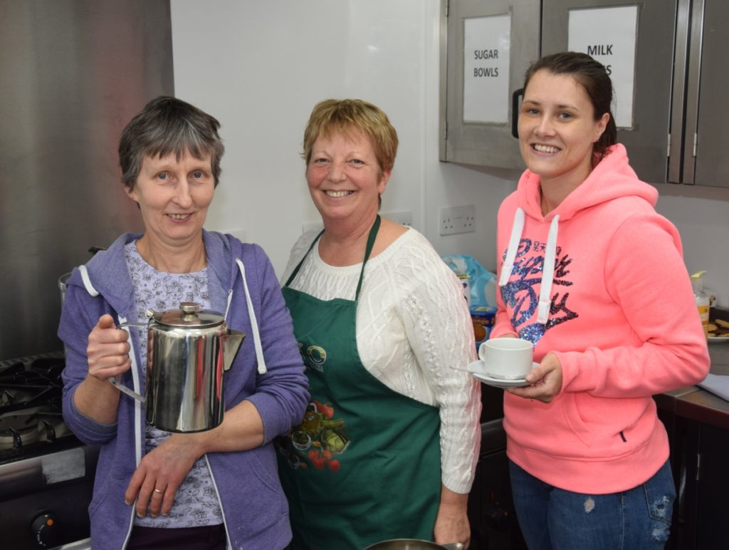 Co-op staff Shona Shaw, left, and Denise Macindeor, right, helped volunteer Elizabeth McCallum in the kitchen.