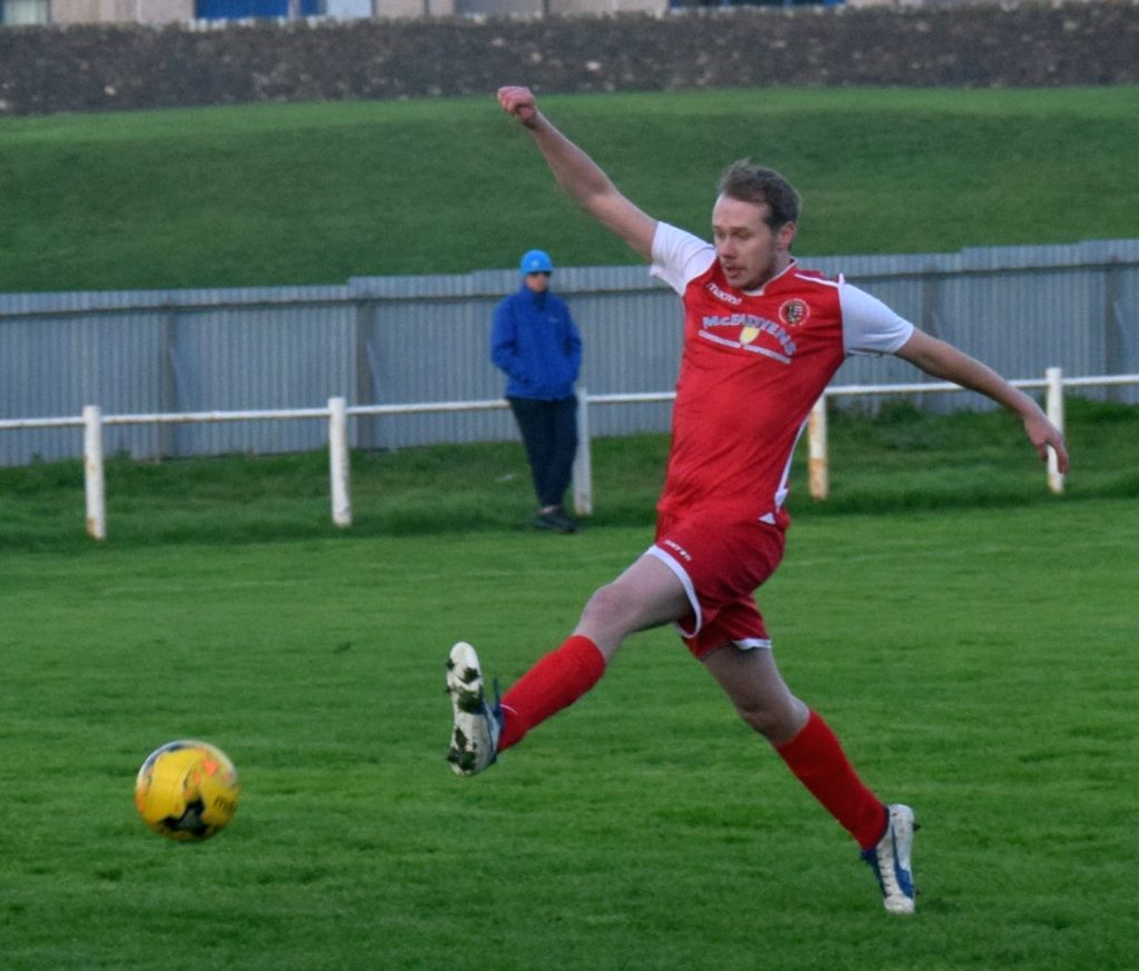 Robbie Dudley marches past the opposition in an attempt on goal.