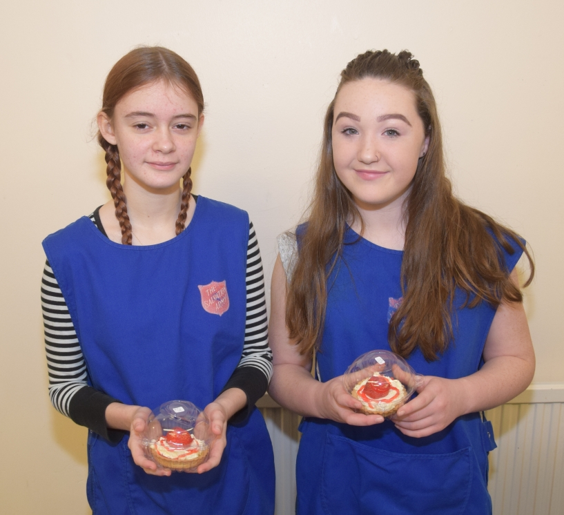 Leah Russell, 13, and Kelsey Graham, 12, hold strawberry tarts made by Kelsey for the event.