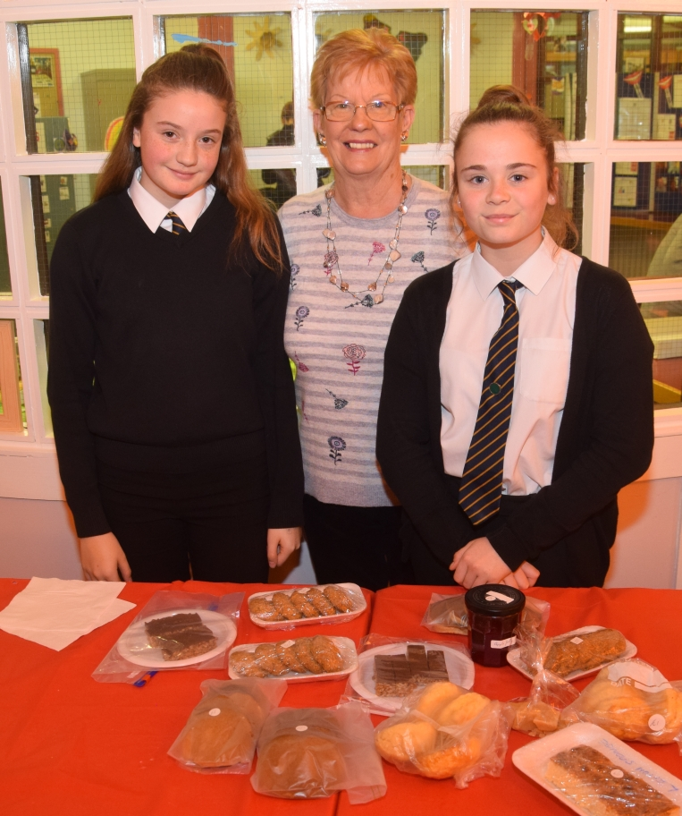 S2 Campbeltown Grammar School students Sophie McSporran, left, and Eryne Barr, right, helped Margaret Innis, assistant development worker, sell baking.
