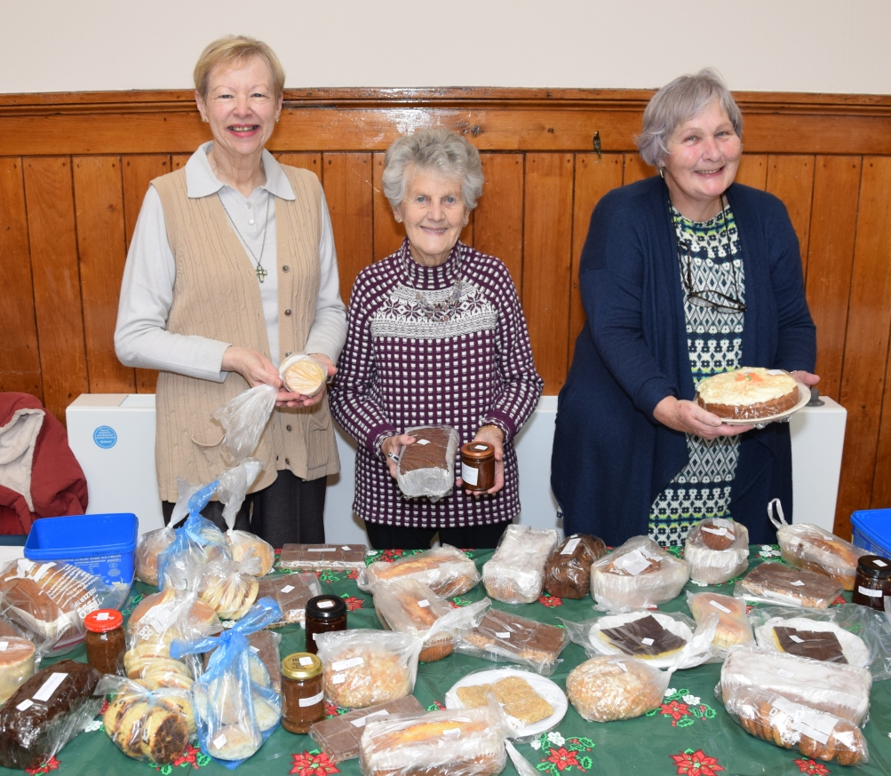 Behind the baking stall, from left to right: Jennifer McKerral, Cathie McGown and Catherine Ann Meikle.