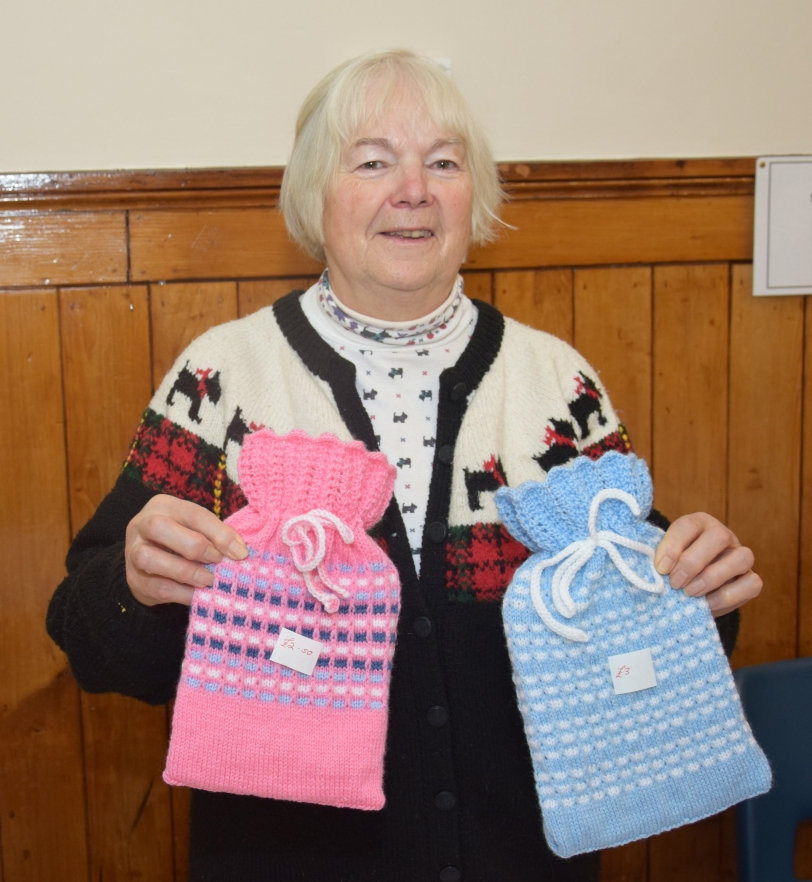 Winter warmers: Moira MacDougall holds hot water bottles with covers knitted by Sissy McCallum.