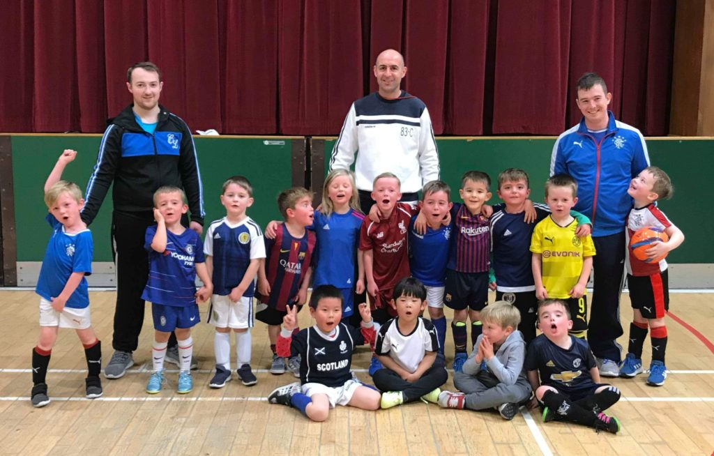 A P1 group with new coaches, back row, from left, George Pope, Billy Gilchrist and Graeme Robertson.