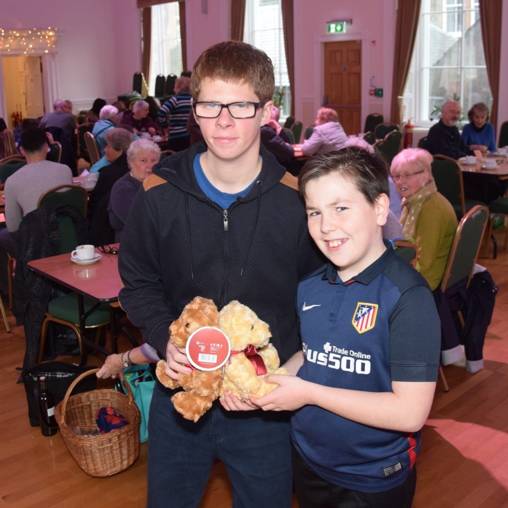 Dan McLean and Ralphy Hill with the prize from the guess the teddies' birthday stall.