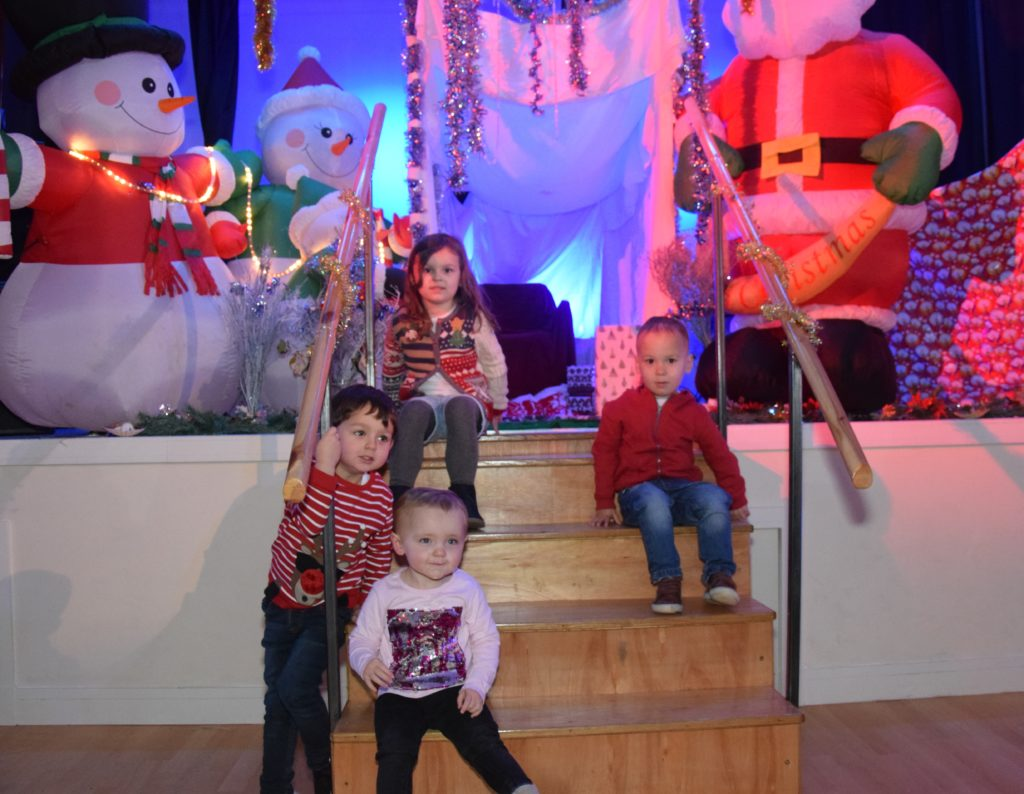 Leah McIvor, four, Lachlan McIvor, two, Archie McCorkindale, three, and Elle Goddard, 21 months, wait patiently for Santa to arrive.