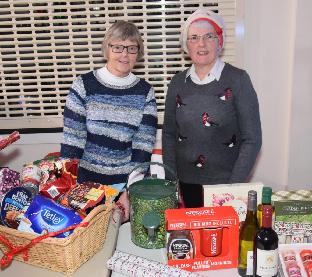 Marion Bell and Margaret Bakes man the raffle stall.