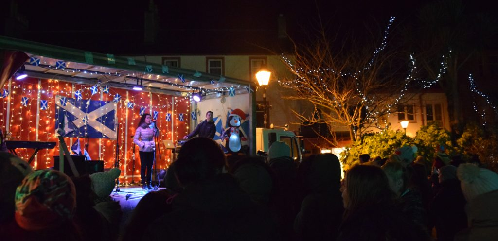 Hannah Black sings alongside the Burnside Square tree lights which came on after the countdown.
