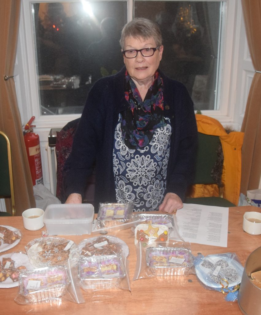 Flora Gillespie, whose daughter Lorraine is in the choir, helped sell baking.