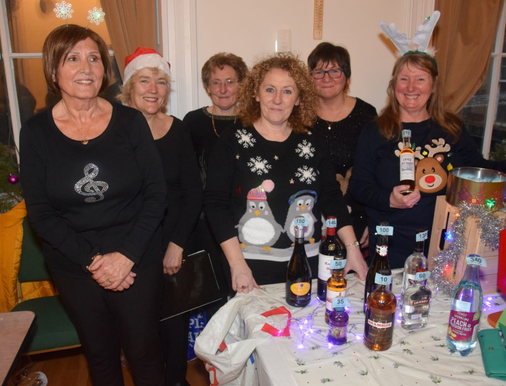 Martha Rennie, Maureen Johnson, Shona Anderson, Senga Dunn, Sheila-anne McCallum and Gail Edwards take a break from the stage to man the bottle stall.
