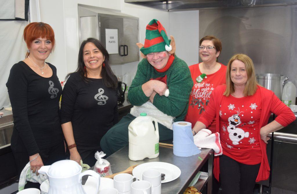 In the kitchen, from left: Valentina Cataldi, Katuska Davies, 'elf on the shelf' Liz Kennedy, Margaret Kelly and Lorraine Gillespie.