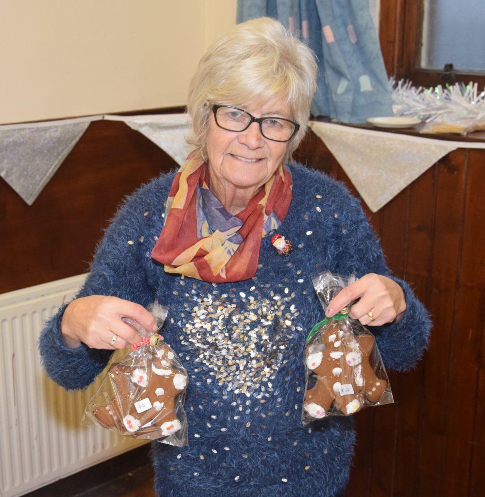 Jen McGrory sold festive baked goods including iced gingerbread men.