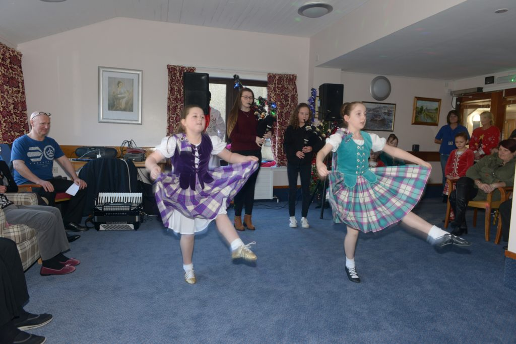 The first Highland dancers take tot he floor. 25_c52LCCshow06