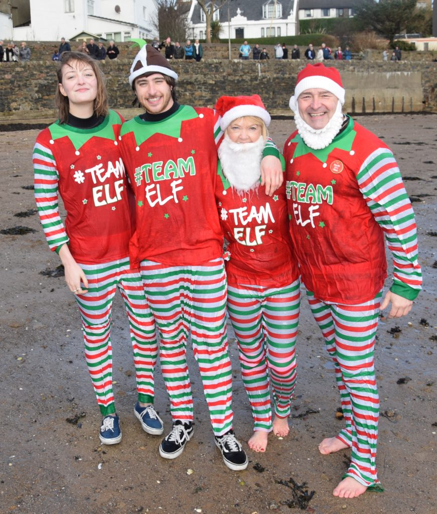 The members of 'Team Elf' were all smiles after taking the plunge.