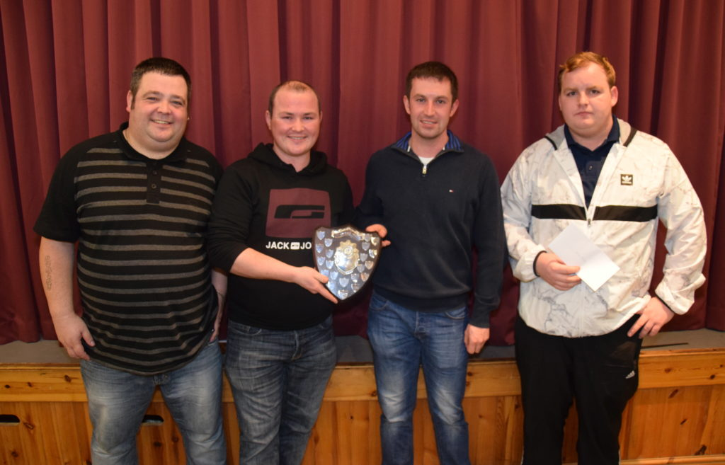 Runners-up Robert Todd, left, and Gavin McLachlan, right, join winners John McCallum and Stuart Currie, holding the shield.