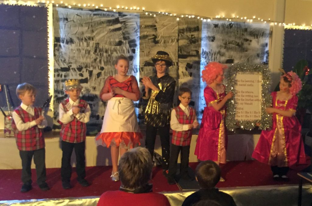 The children performing a song during the pantomime.