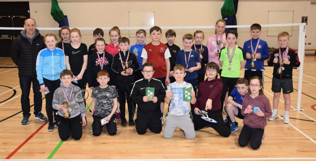 Prizewinners at the Kintyre Primary Schools Badminton Competition, with Stuart McQuaker, left.