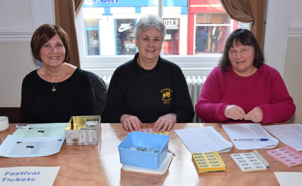 Martha Rennie, Linda Brannigan and Susan Paterson sell raffle tickets and drama festival tickets.