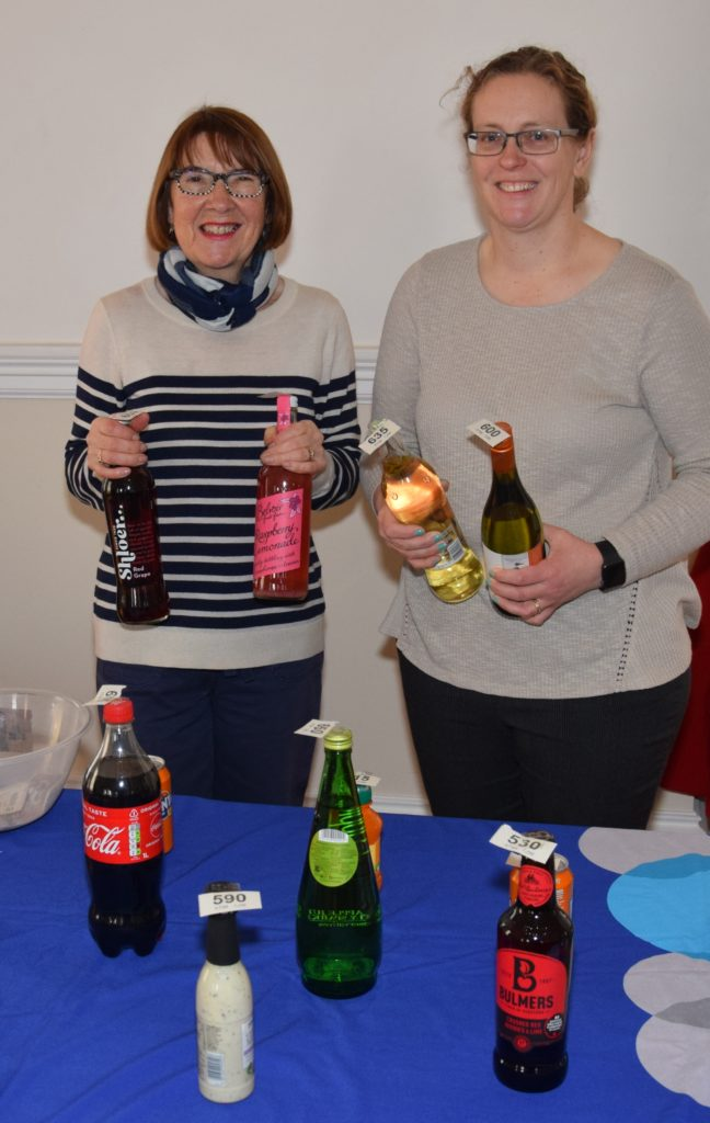 Pat Healey and Valerie Mackay behind the bottle stall.