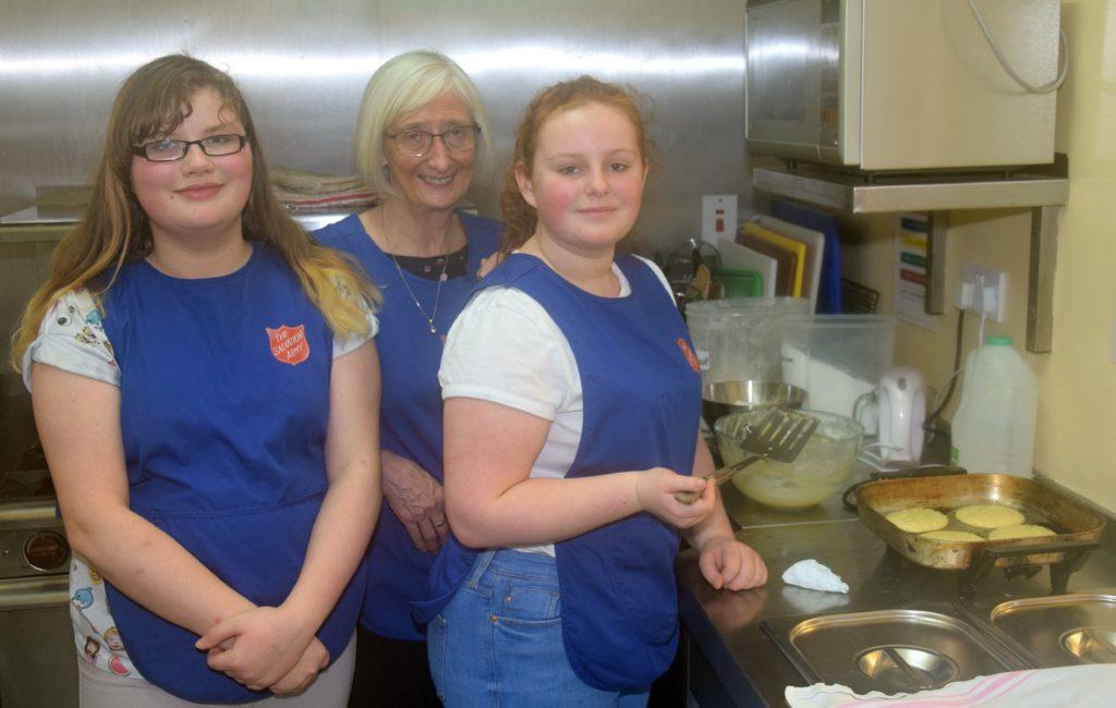 Brooke Oxborrow, Margaret Raeside and Tianna McMillan making perfect pancakes.