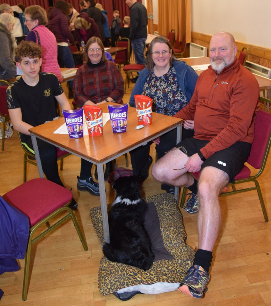 Poppy's Team: Lewis Gilchrist, Sheila MacSporran, Briony Avery and David Avery, with Poppy under the table.