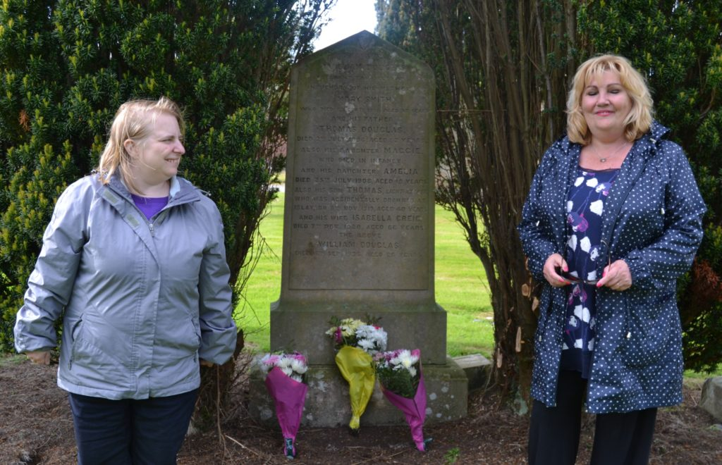 Andrea Sager and Jean Douglas at the Douglas family's monument in Kilkerran Cemetery.