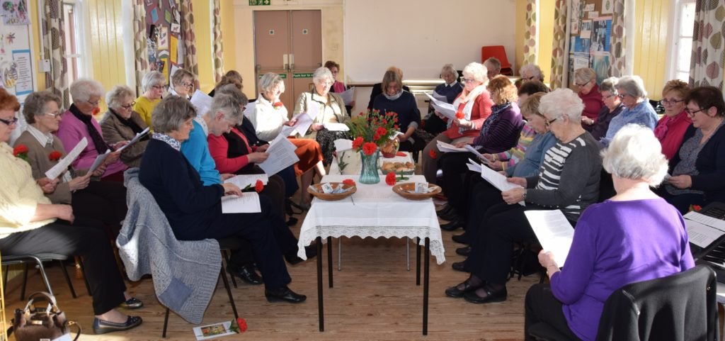 The congregation sat round a table of items symbolic to Slovenia.