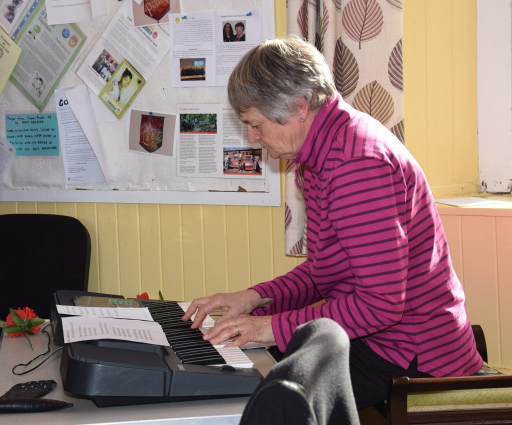 Maggie Young accompanied hymns on the keyboard.
