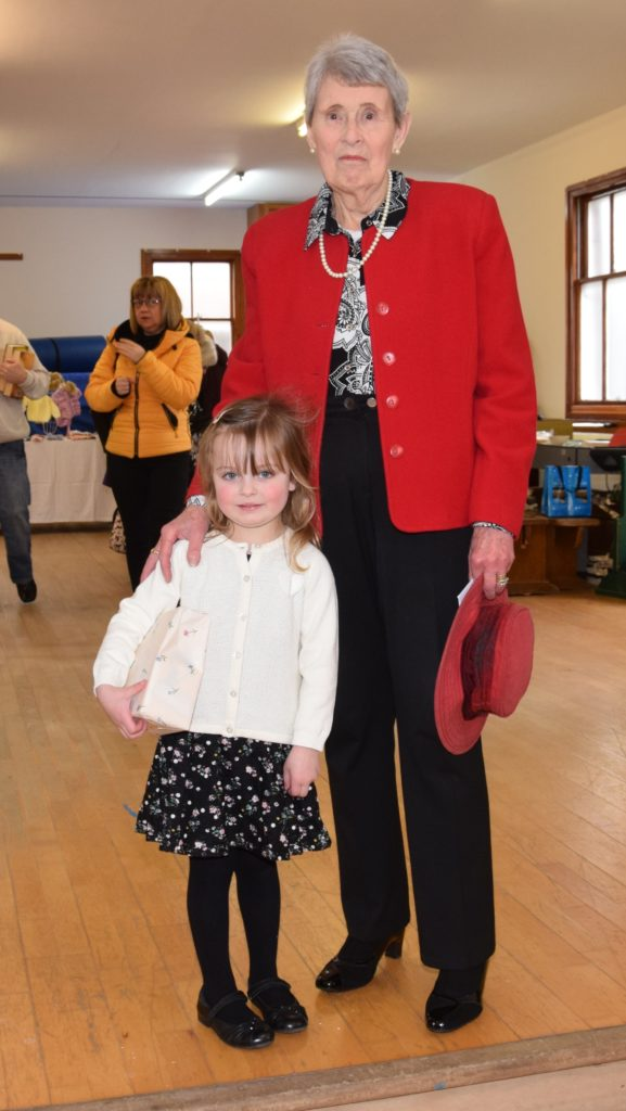 Catherine Spence with one of the sale's youngest visitors, four-year-old Isla Graham.