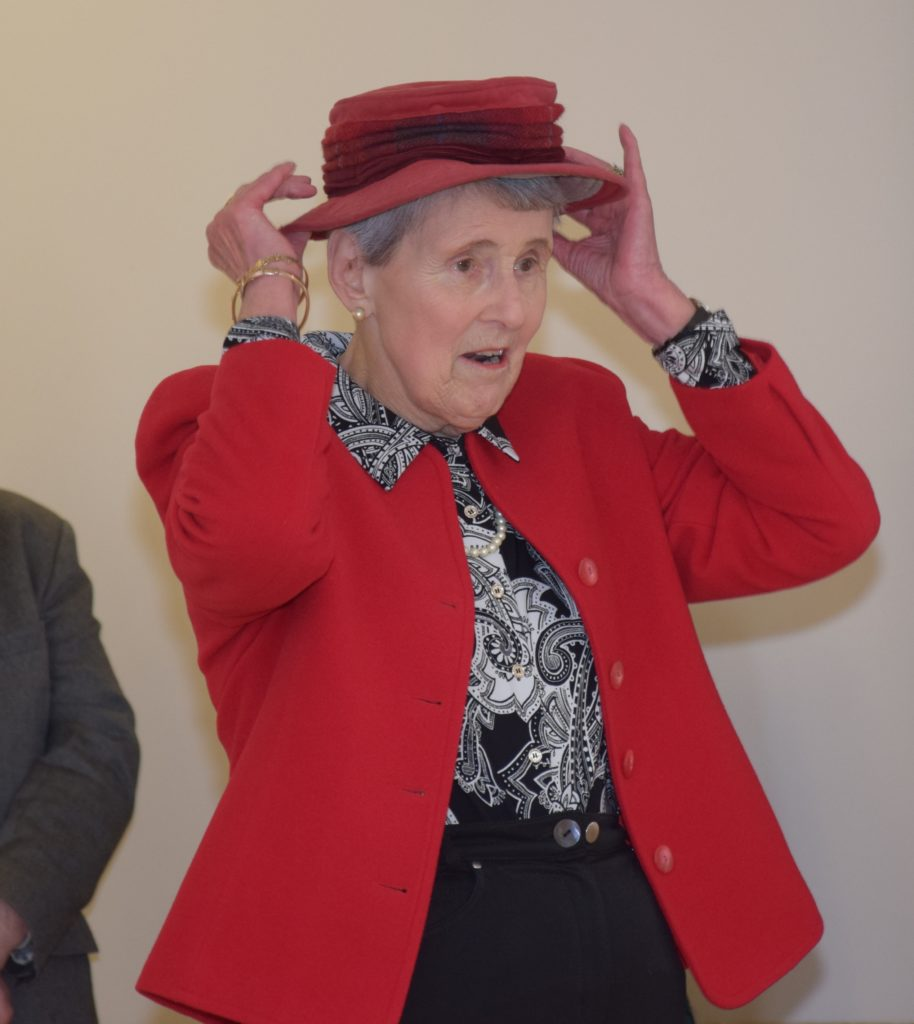 Catherine Spence dons a red hat as she opens the sale.
