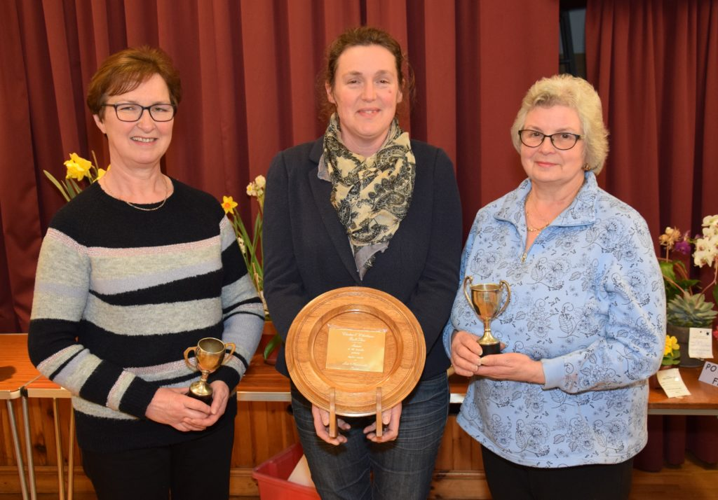 From left, Jane McCallum won the Baking Cup, Zoe Weir won the Liz Dale Trophy for most points in the arts and handcrafts section, and Glynis Lewin won the Floral Cup.