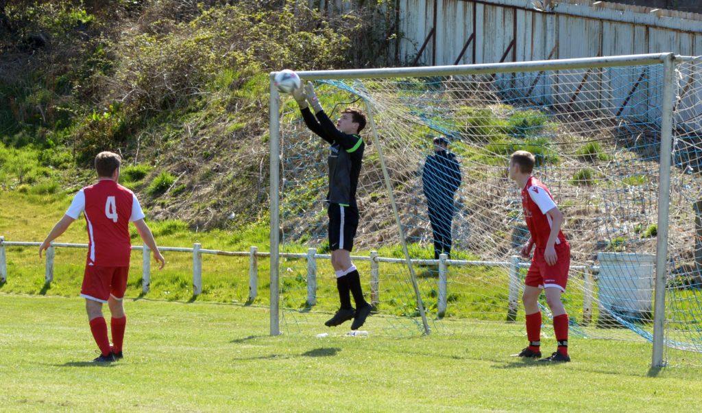 Pupils goalkeeper Alasdair Ferguson saves a free kick.
