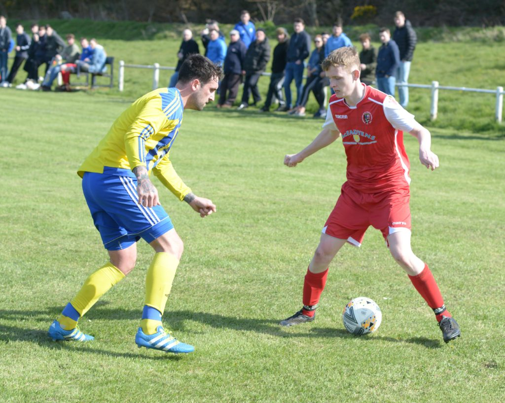 Ross Souden keeps control of the ball.