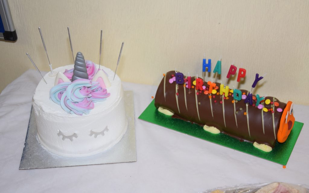 There were two cakes to celebrate the anniversary of Youth Impact opening.