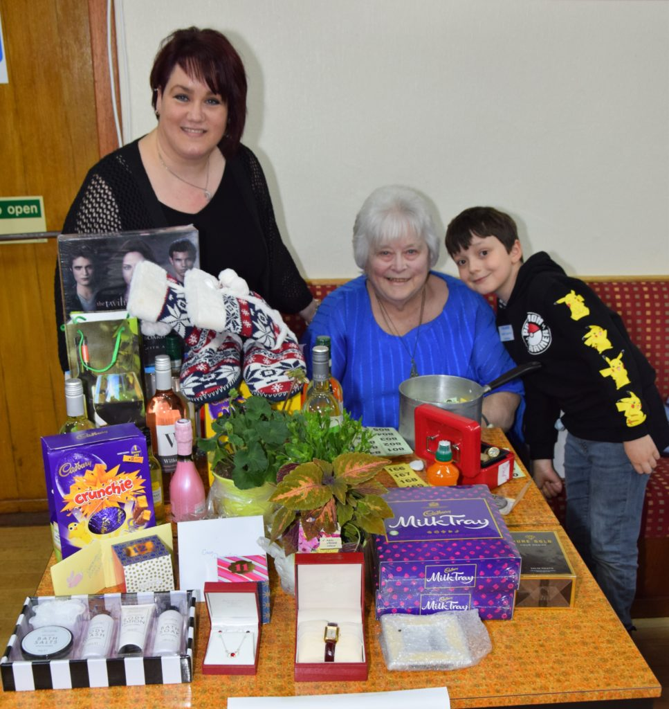 From left: Michele Prout, Lesley Mitchell, and 'chief raffle runner' Fraser Gildea, seven, from Helensburgh.