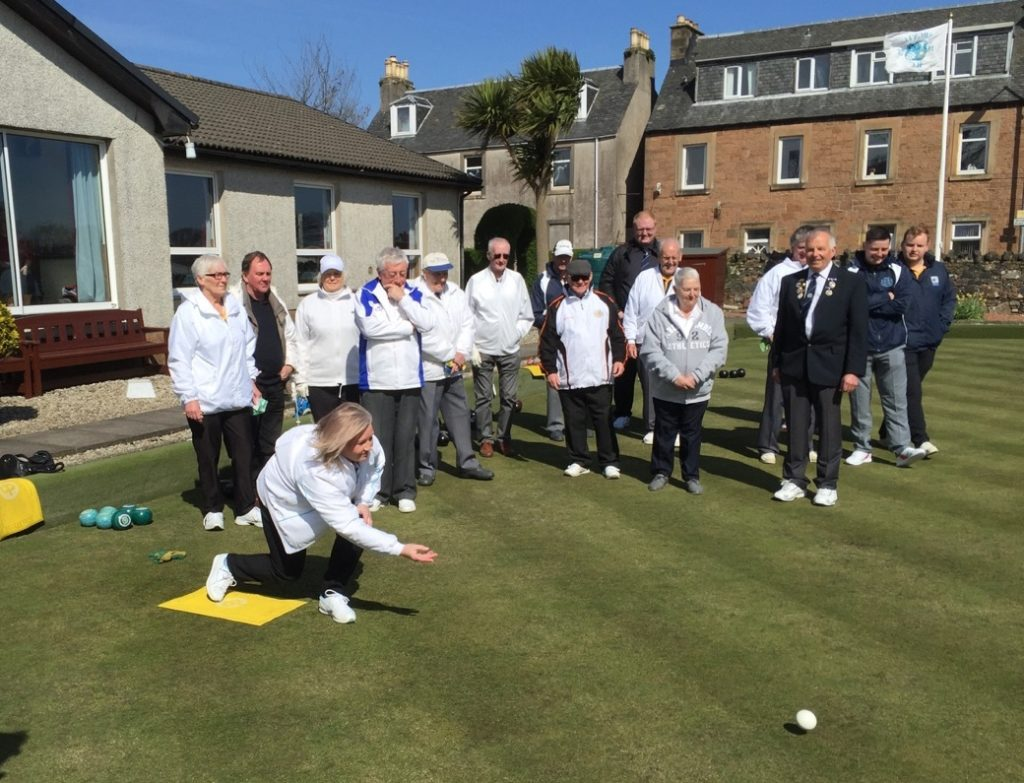 At Argyll Bowling Club, president Kenny Kerr's wife, Alison, rolls the first jack.