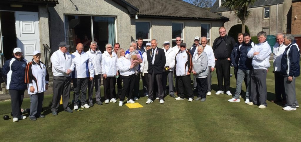 Argyll Bowling Club members with the president's wife, Alison Kerr, after she was presented with a flowers.