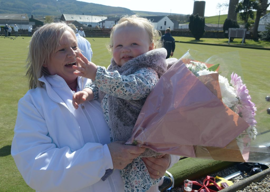 Alison Kerr was presented with flowers by her granddaughter Charlotte.