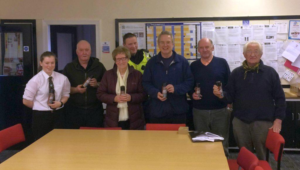 With cans of graffiti remover are, from left: Iona Campbell, Robert Strang, Eva MacDonald MBE, PC John McGeachy, Andrew Hemmings, John McDowall and Walter Bell.