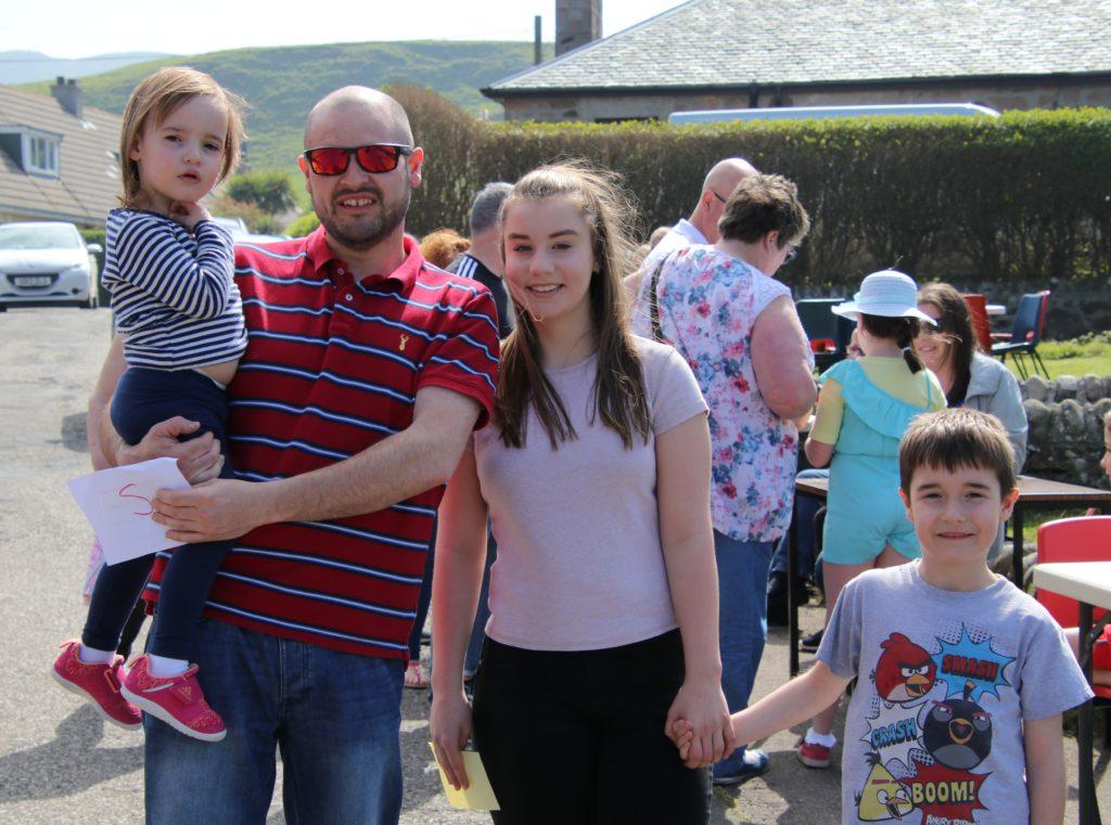 Jamie Eaton, holding Charlotte Eaton, Maddie Allison and Oscar Eaton.