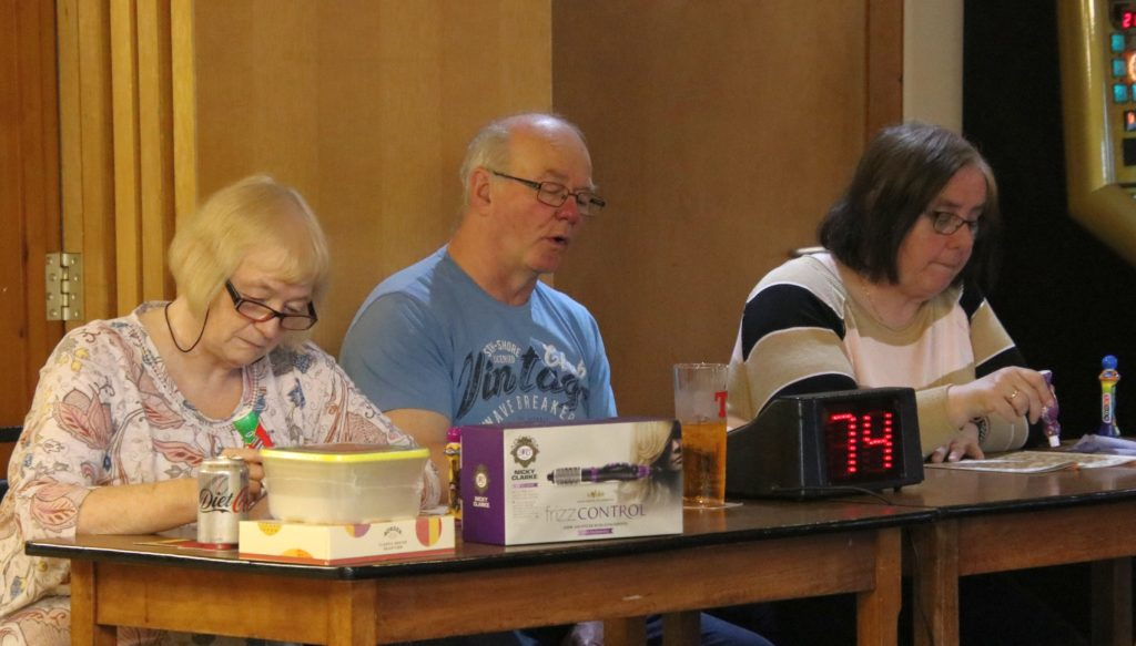 Isobel Dalziel, Donny McCrimmon and Elizabeth McCrimmon concentrate on the numbers.