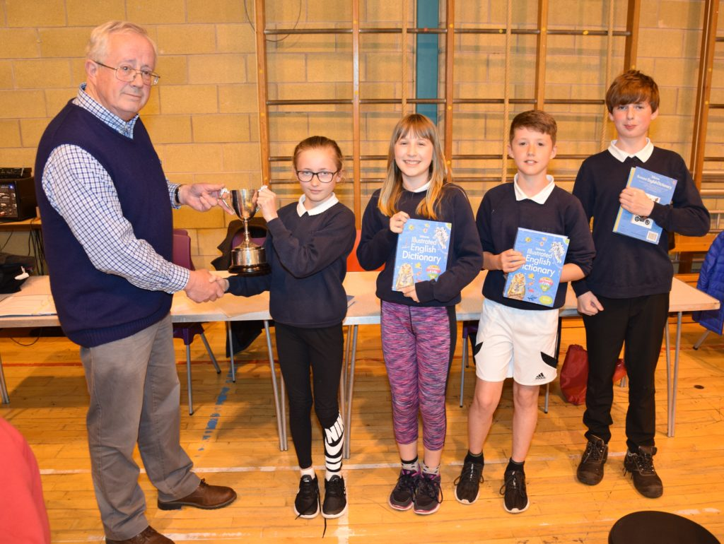 Alan Milstead of the Rotary Club of Campbeltown presents the trophy to the winning team of Kirstie Renton, Mae Barr, Lewis Graham and James MacMillan.